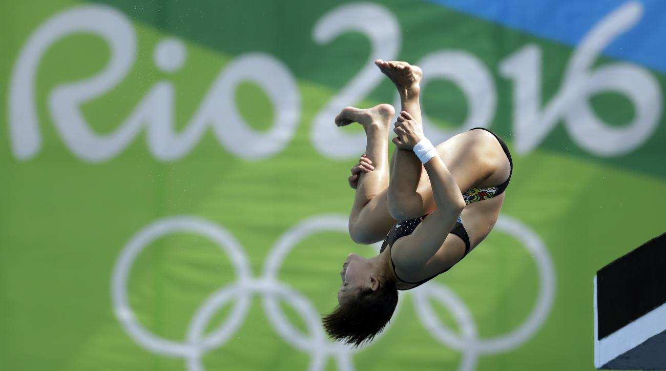 China's Ren Qian competes during the women's 10-meter platform diving semi final in the Maria Lenk Aquatic Center at the 2016 Summer Olympics in Rio de Janeiro, Brazil, Thursday, Aug. 18, 2016. (AP Photo/Michael Sohn)