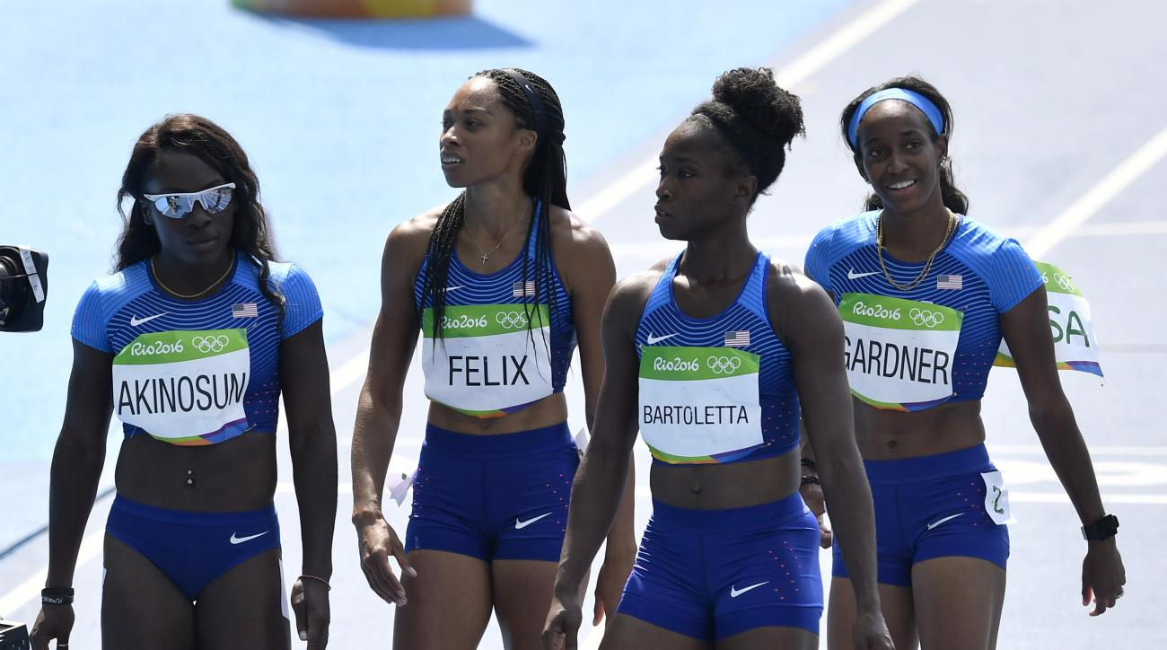 From left, the United States 4x100-meter relay team Morolake Akinosun, Allyson Felix, Tianna Bartoletta and English Gardner after a women's 4x100-meter relay heat during the athletics competitions of the 2016 Summer Olympics at the Olympic stadium in Rio