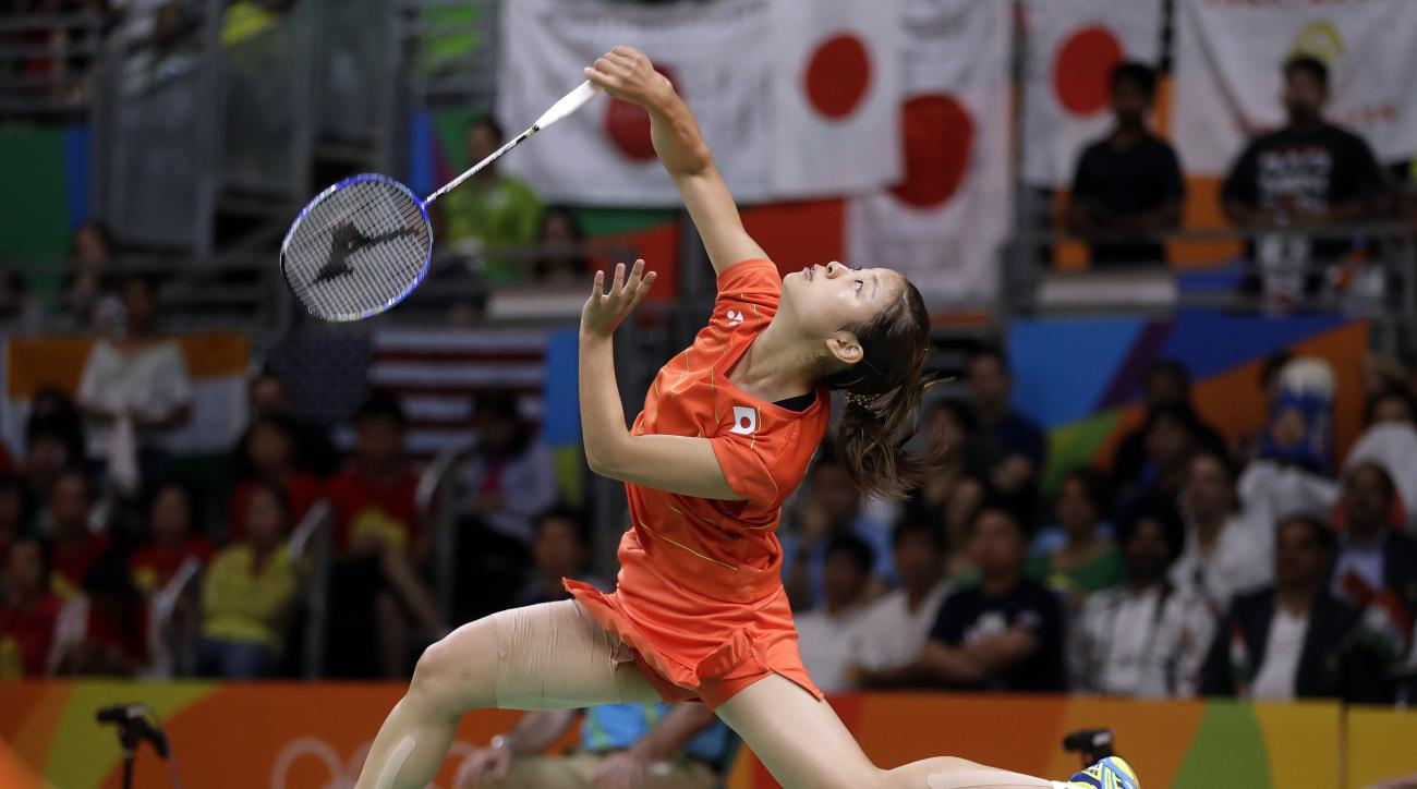 Japan's Nozomi Okuhara plays against India's Sindhu Pusarla during a women's singles semifinal badminton match at the 2016 Summer Olympics in Rio de Janeiro, Brazil, Thursday, Aug. 18, 2016. (AP Photo/Kin Cheung)