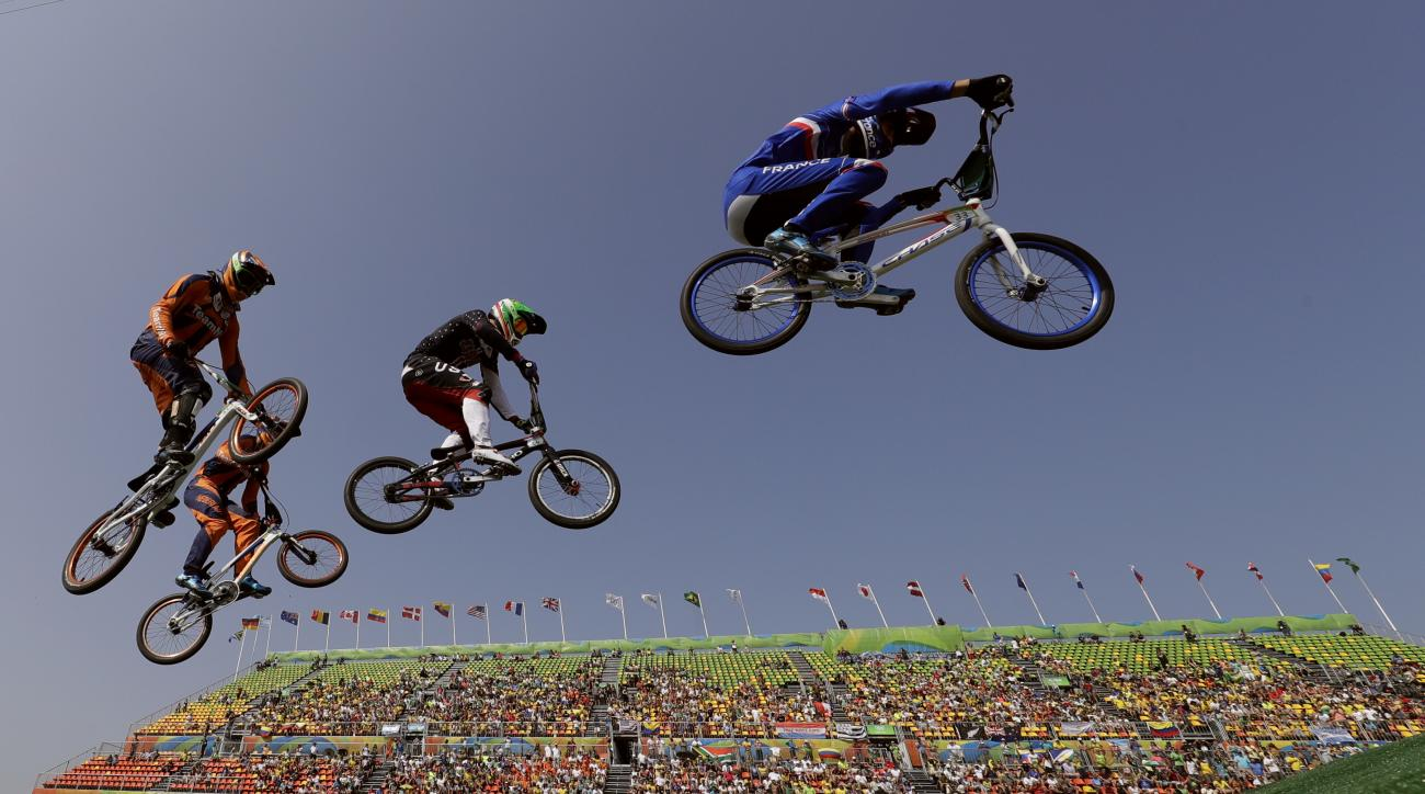 Cyclists, from right, Joris Daudet of France, Nicholas Long of the United States, Niek Kimmann of the Netherlands and Jelle van Gorkom of the Netherlands compete in the BMX cycling quarterfinals during the 2016 Summer Olympics in Rio de Janeiro, Brazil, T