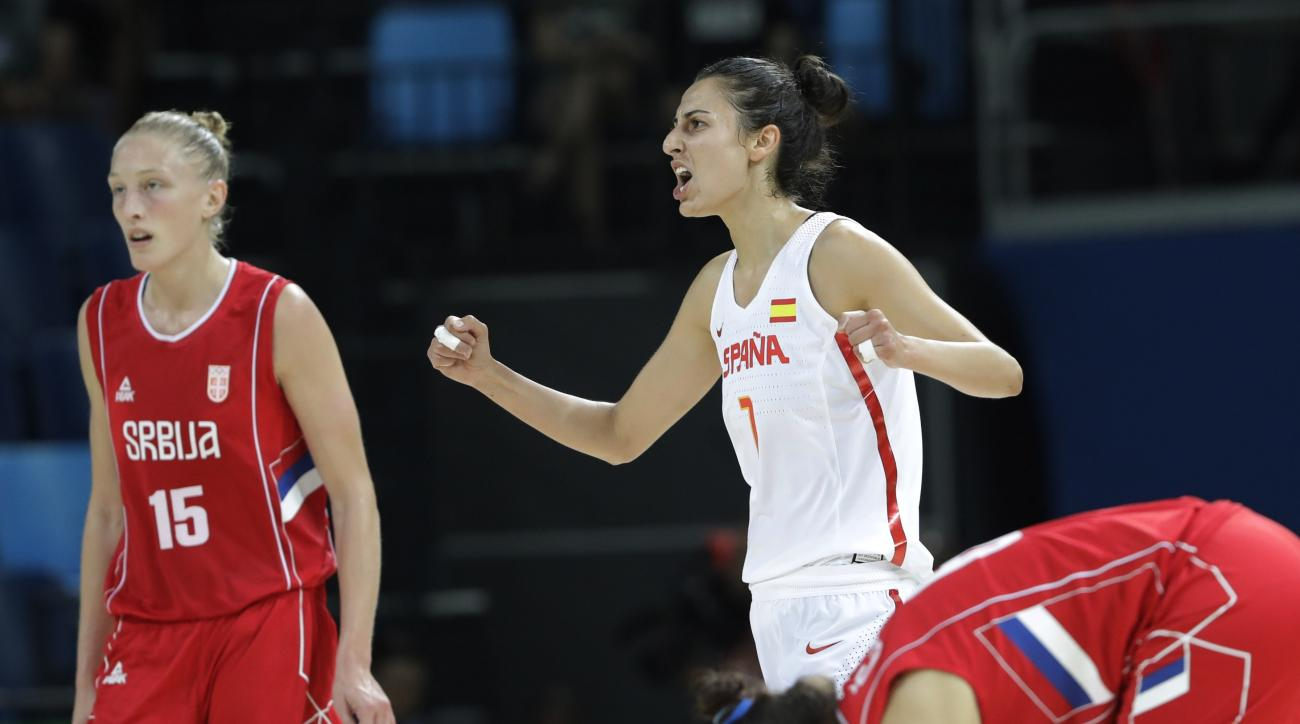 Spain's Alba Torrens (7) celebrates a play  during a women's semifinal round basketball game against Serbia at the 2016 Summer Olympics in Rio de Janeiro, Brazil, Thursday, Aug. 18, 2016. (AP Photo/Eric Gay)