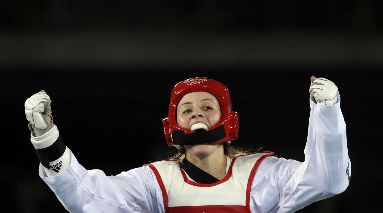 Jade Jones of Great Britain celebrates after defeating Nikita Glasnovic of Sweden in a women's Taekwondo 57-kg semifinal at the 2016 Summer Olympics in Rio de Janeiro, Brazil, Thursday, Aug. 18, 2016. (AP Photo/Andrew Medichini)