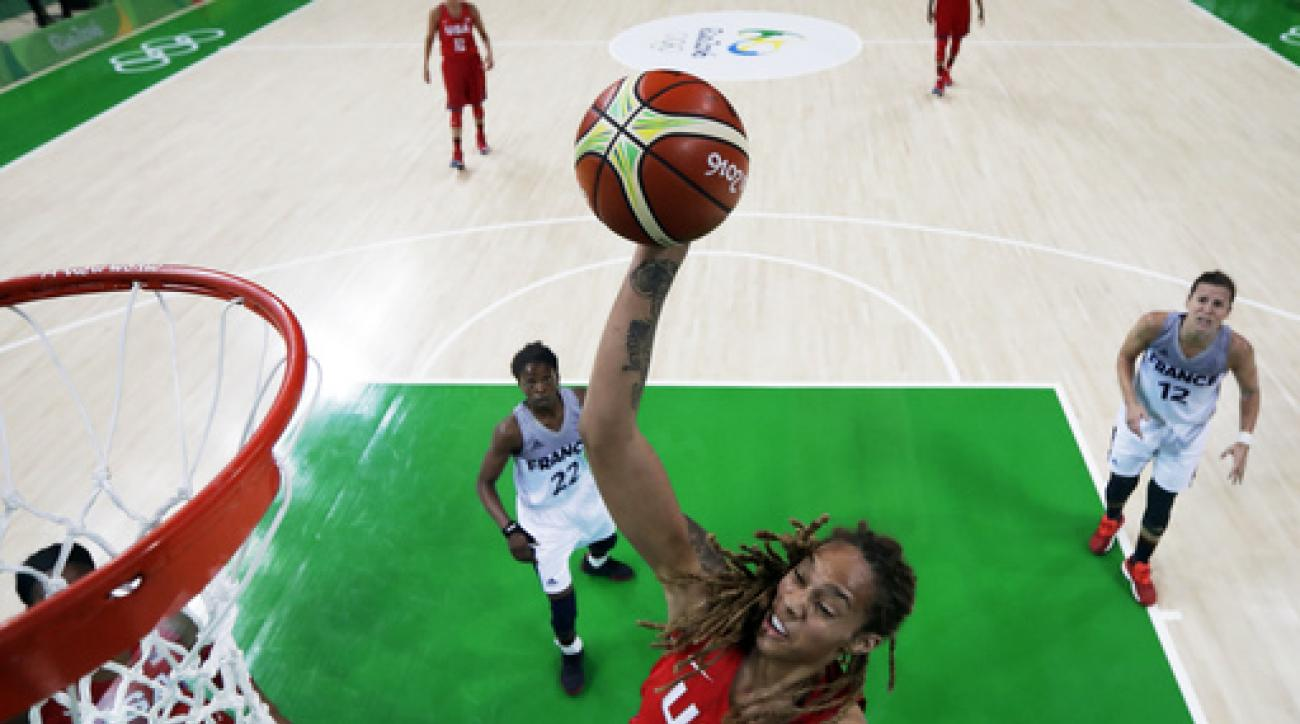 United States' Brittney Griner (15) drives to the basket past France's Olivia Epoupa, left, and Gaelle Skrela, right, during a semifinal round basketball game at the 2016 Summer Olympics in Rio de Janeiro, Brazil, Thursday, Aug. 18, 2016. (AP Photo/Charli