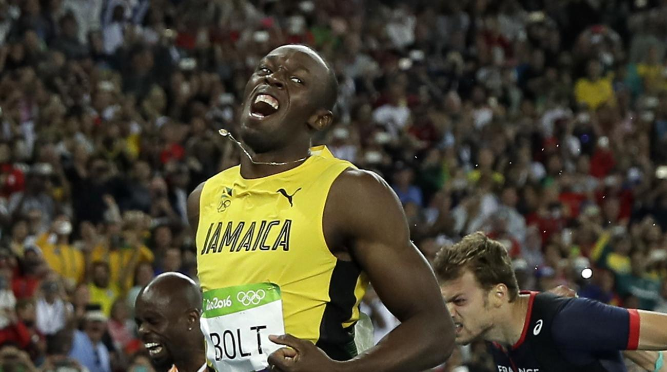 Usain Bolt from Jamaica celebrates after crossing the line to win the gold medal in the men's 200-meter final during the athletics competitions of the 2016 Summer Olympics at the Olympic stadium in Rio de Janeiro, Brazil, Thursday, Aug. 18, 2016. (AP Phot