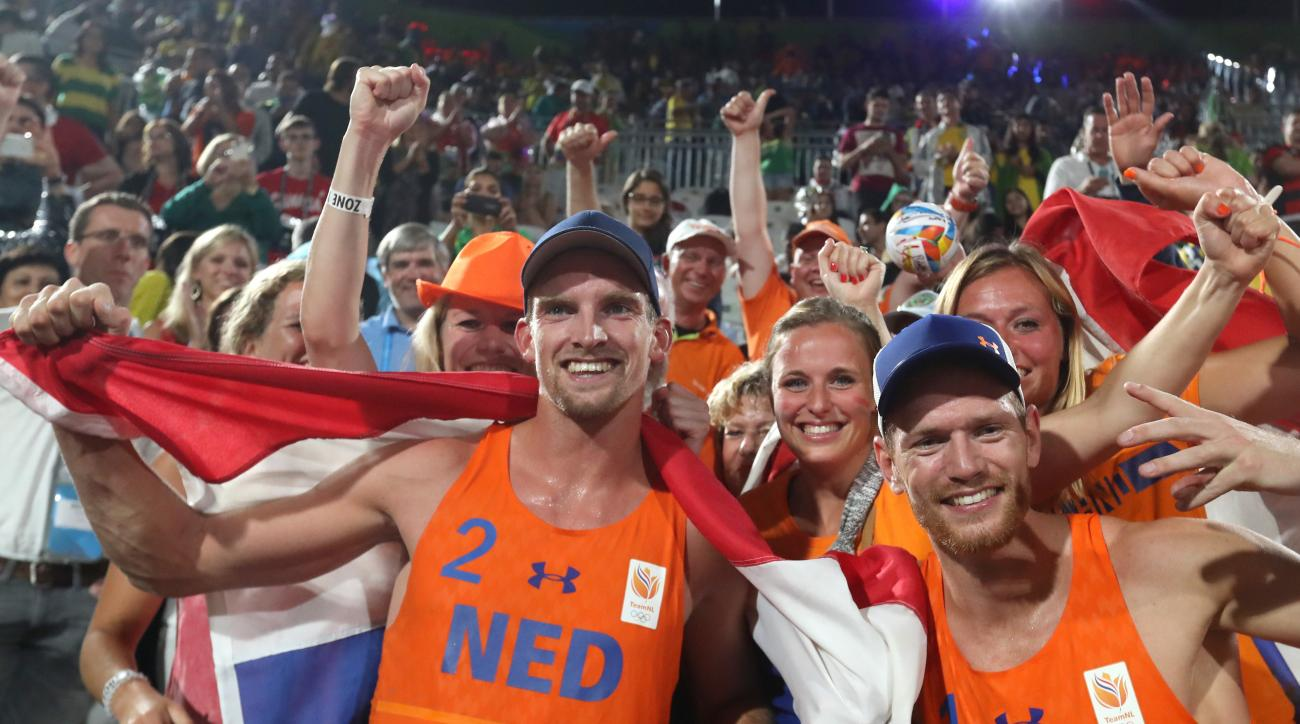 Netherlands' Alexander Brouwer, right, and Robert Meeuwsen, left, celebrates with fans and family after winning a men's beach volleyball bronze medal match against Russia at the 2016 Summer Olympics in Rio de Janeiro, Brazil, Thursday, Aug. 18, 2016. (AP