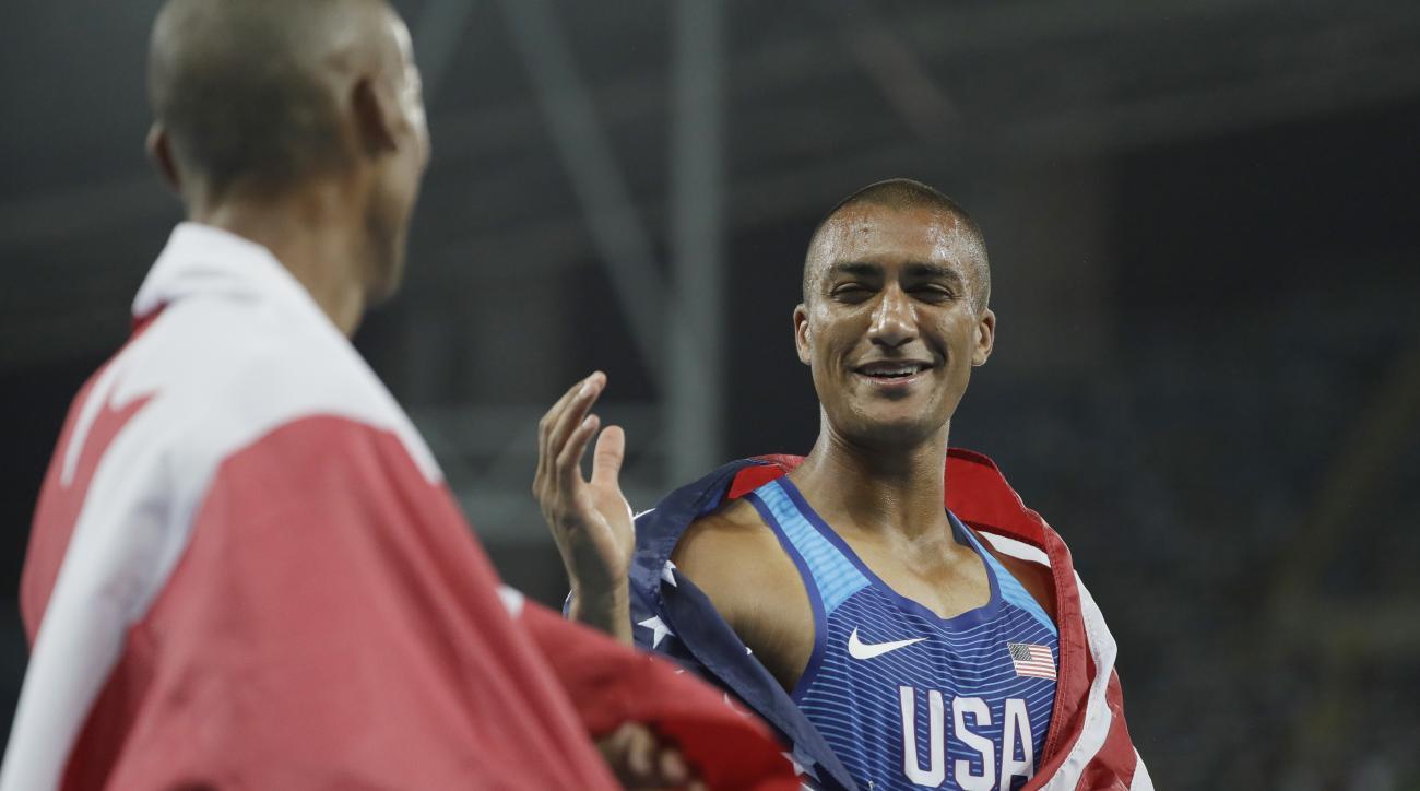 United States' Ashton Eaton celebrates winning the gold medal in the men's decathlon during the athletics competitions of the 2016 Summer Olympics at the Olympic stadium in Rio de Janeiro, Brazil, Thursday, Aug. 18, 2016. (AP Photo/David J. Phillip)