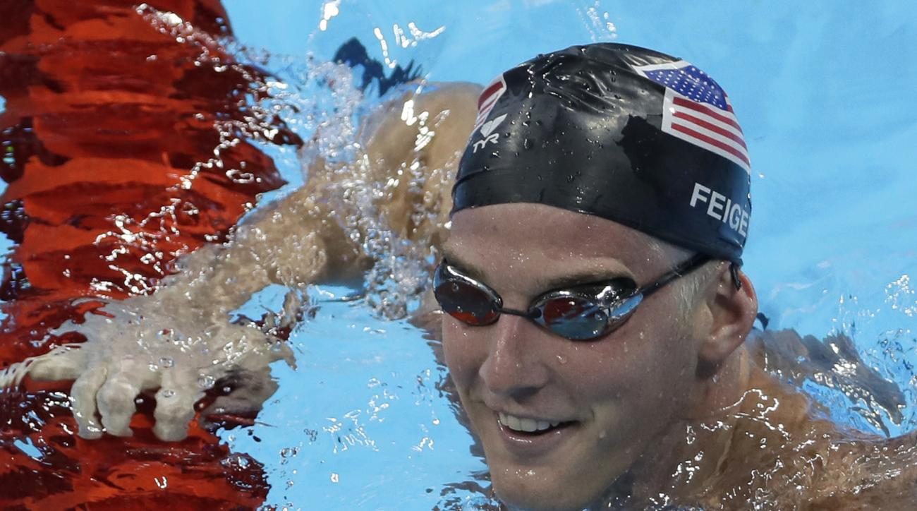 FILE - In this Aug. 2, 2016, file photo, United States James Feigen smiles during a swimming training session prior to the 2016 Summer Olympics in Rio de Janeiro, Brazil. Feigen was one of four American Olympic swimmers in connection to a story of being h