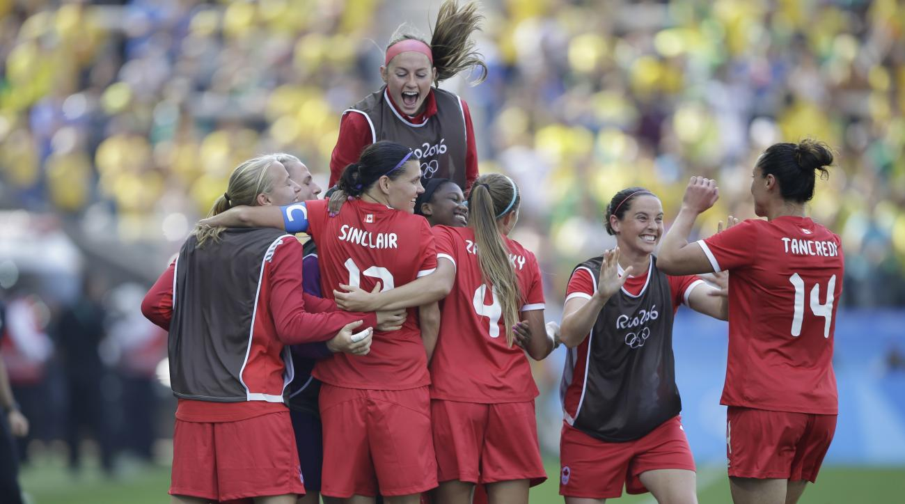 Canada players celebrates after Christine Sinclair scoring their side's second goal during the bronze medal match of the women's Olympic football tournament between Brazil and Canada at the Arena Corinthians stadium in Sao Paulo, Friday Aug. 19, 2016. (AP