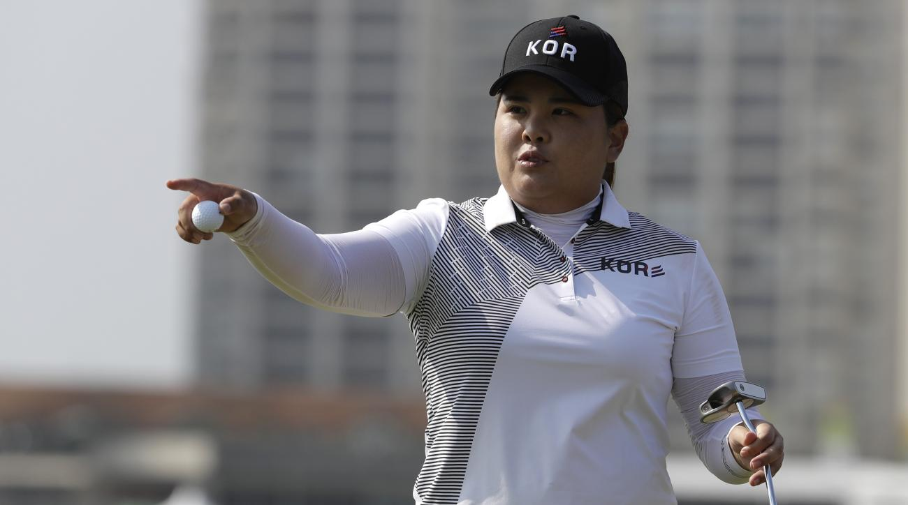 Inbee Park of South Korea gestures after putting the 10th hole during the third round of the women's golf event at the 2016 Summer Olympics in Rio de Janeiro, Brazil, Friday, Aug. 19, 2016. (AP Photo/Alastair Grant)