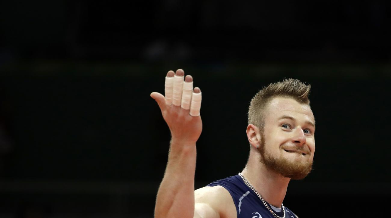 Italy's Ivan Zaytsev celebrates during a men's semifinal volleyball match against the United States at the 2016 Summer Olympics in Rio de Janeiro, Brazil, Friday, Aug. 19, 2016. (AP Photo/Matt Rourke)