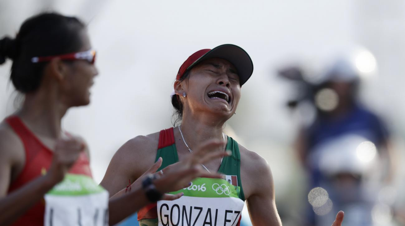 Maria Guadalupe Gonzalez, of Mexico, reacts after crossing the finish line in second place in the women's 20-km race walk at the 2016 Summer Olympics in Rio de Janeiro, Brazil, Friday, Aug. 19, 2016. (AP Photo/Robert F. Bukaty)