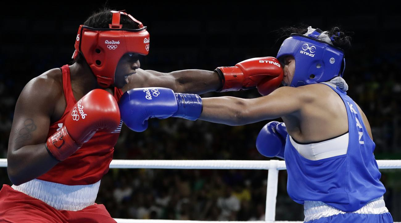 CORRECTS SPELLING OF CLARESSA - United States' Claressa Maria Shields, left, fights Kazakhstan's Dariga Shakimova during a women's middleweight 75-kg semifinals boxing match at the 2016 Summer Olympics in Rio de Janeiro, Brazil, Friday, Aug. 19, 2016. (AP