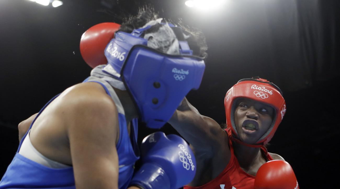 CORRECTS SPELLING OF CLARESSA - United States' Claressa Maria Shields, right, fights Kazakhstan's Dariga Shakimova during a women's middleweight 75-kg semifinals boxing match at the 2016 Summer Olympics in Rio de Janeiro, Brazil, Friday, Aug. 19, 2016. (A