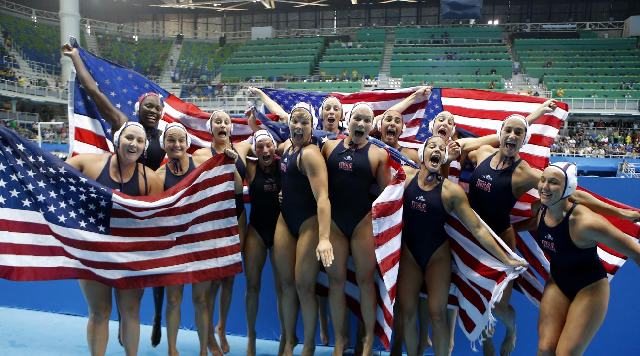 Members of the United States women's water polo team celebrate after winning the gold medal match against Italy at the 2016 Summer Olympics in Rio de Janeiro, Brazil, Friday, Aug. 19, 2016. (AP Photo/Eduardo Verdugo)
