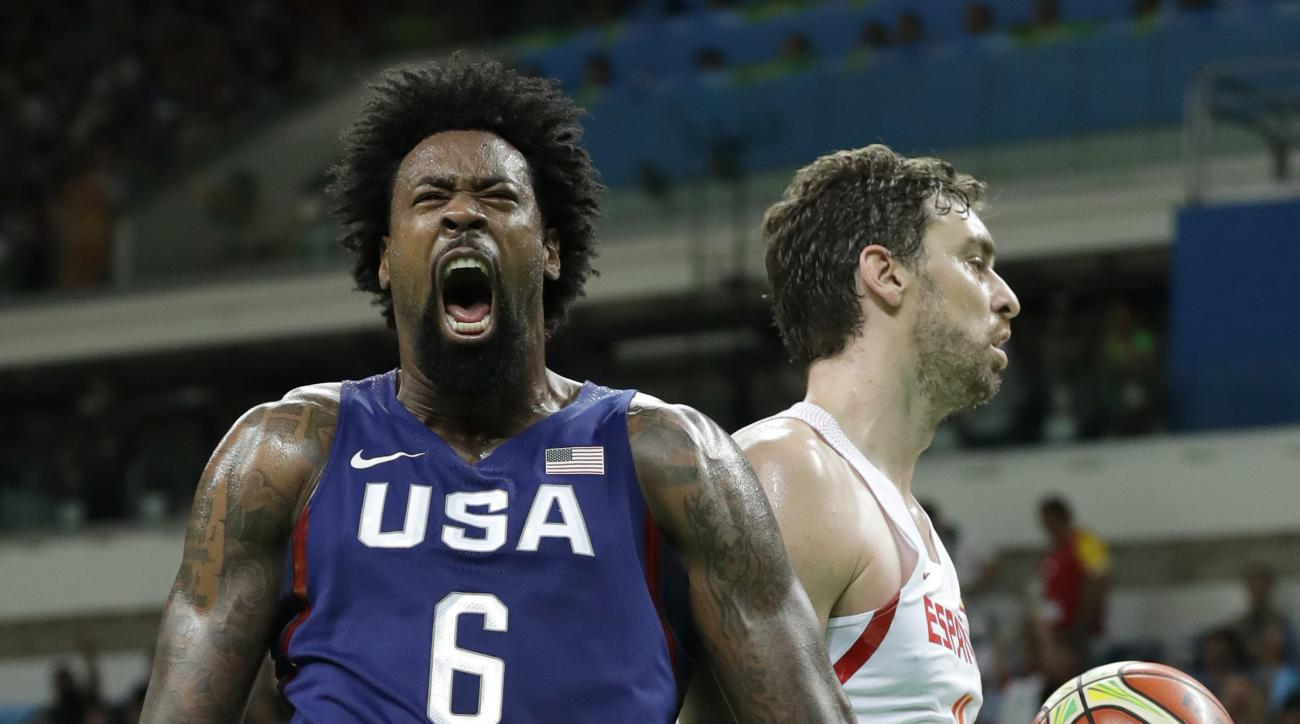 United States' DeAndre Jordan (6) celebrates in front of Spain's Pau Gasol, right, after dunking the ball during a semifinal round basketball game at the 2016 Summer Olympics in Rio de Janeiro, Brazil, Friday, Aug. 19, 2016. (AP Photo/Charlie Neibergall)