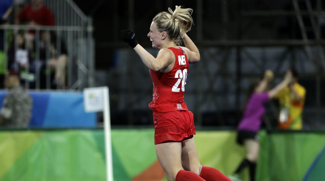 Britain's Hollie Webb, jumps as she celebrates after she scored the last winning penalty shootout goal against Netherlands, during a women's field hockey gold medal match at 2016 Summer Olympics in Rio de Janeiro, Brazil, Friday, Aug. 19, 2016. (AP Photo/
