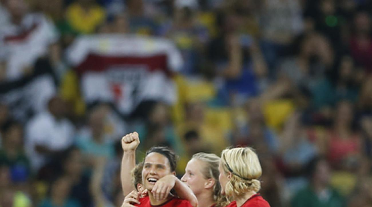 Germany's Dzsenifer Marozsan, left, celebrates with her teammates scoring hers side's first goal during the final of the women's Olympic football tournament between Germany and Sweden at Maracana stadium in Rio de Janeiro, Brazil, Friday, Aug. 19, 2016. (