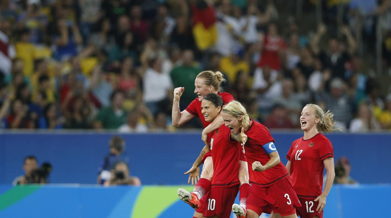 Germany's Dzsenifer Marozsan (10) celebrates with her teammates scoring hers side's first goal during the final of the women's Olympic football tournament between Germany and Sweden at Maracana stadium in Rio de Janeiro, Brazil, Friday, Aug. 19, 2016. (AP