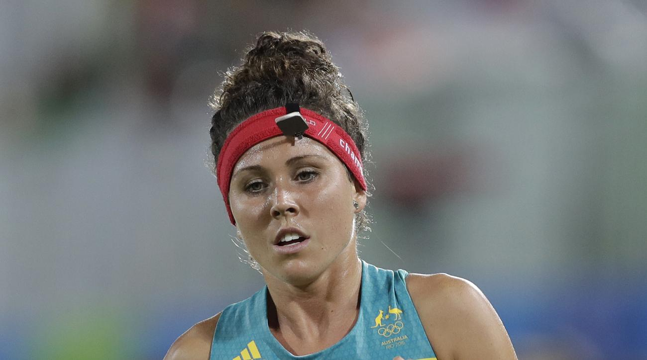 Gold medal winner Chloe Esposito of Australia competes during the running and shooting portion of the women's modern pentathlon at the Summer Olympics in Rio de Janeiro, Brazil, Friday, Aug. 19, 2016. (AP Photo/Kirsty Wigglesworth)