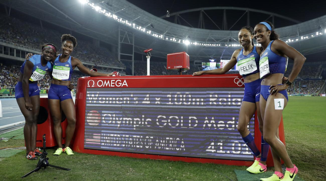 United States's Tianna Bartoletta, second left, Allyson Felix, second right, English Gardner, right and Tori Bowie, left, during the athletics competitions of the 2016 Summer Olympics at the Olympic stadium in Rio de Janeiro, Brazil, Friday, Aug. 19, 2016