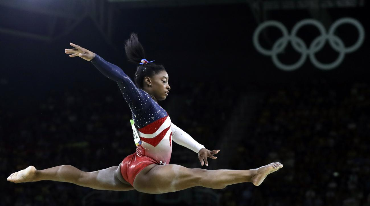 FILE - In this Aug. 9, 2016 file photo, United States' Simone Biles performs on the balance beam during the artistic gymnastics women's team final at the Summer Olympics in Rio de Janeiro, Brazil. Many of the Olympics most memorable moments have come cour