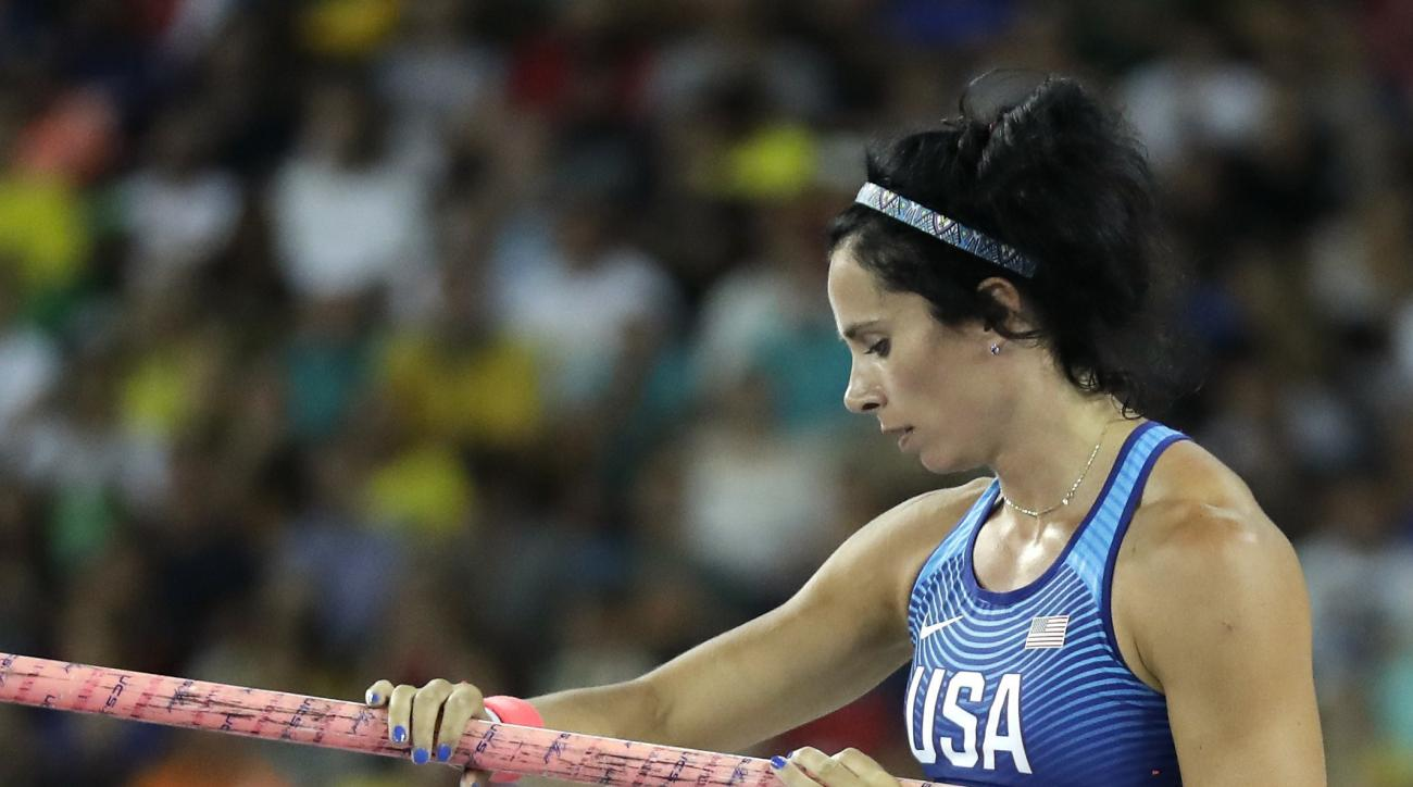 United States' Jennifer Suhr leaves the mat after dropping out from the women's pole vault final during the athletics competitions of the 2016 Summer Olympics at the Olympic stadium in Rio de Janeiro, Brazil, Friday, Aug. 19, 2016. (AP Photo/Matt Dunham)