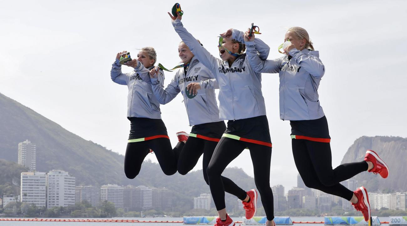Germany's Sabrina Hering, Franzi Weber, Steffi Kriegerstein and Tina Dietze celebrate their silver medals in the women's kayak four 500m final during the 2016 Summer Olympics in Rio de Janeiro, Brazil, Saturday, Aug. 20, 2016. (AP Photo/Matt York)