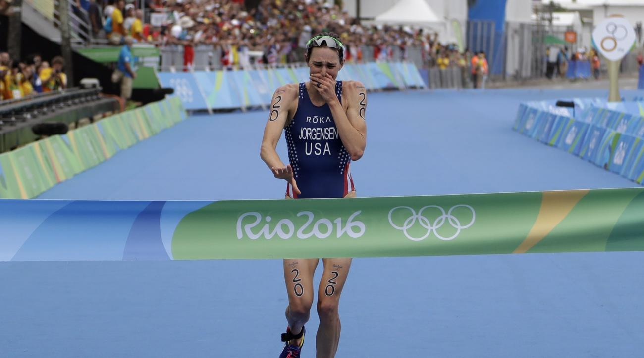Gwen Jorgensen of the United States wins the women's triathlon competition of the 2016 Summer Olympics in Rio de Janeiro, Brazil, Saturday, Aug. 20, 2016. (AP Photo/Gregory Bull)
