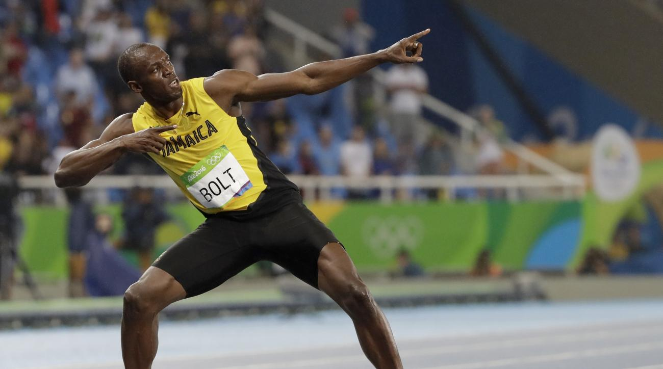 FILE - In this Aug. 18, 2016 file photo, Usain Bolt from Jamaica celebrates winning the gold medal in the men's 200-meter final during the athletics competitions of the 2016 Summer Olympics at the Olympic stadium in Rio de Janeiro, Brazil. (AP Photo/David