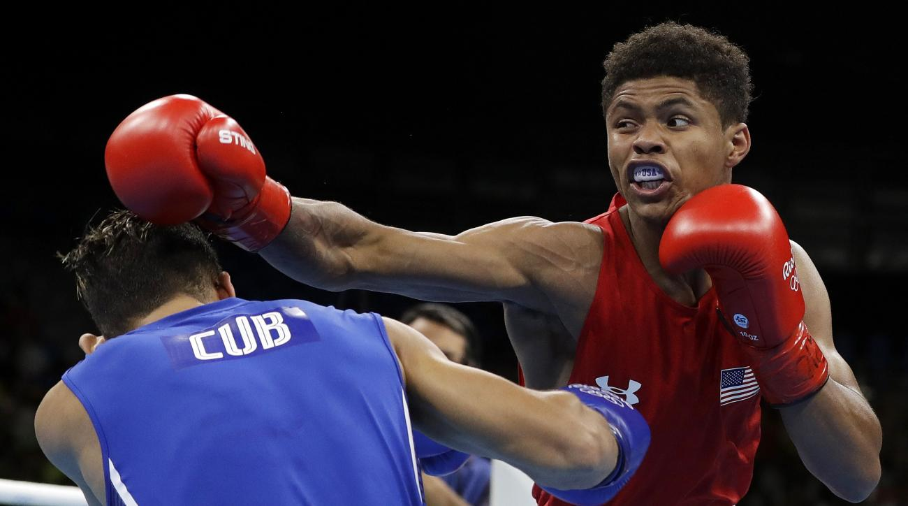 United States' Shakur Stevenson, right, fights Cuba's Robeisy Ramirez during a men's bantamweight 56-kg final boxing match at the 2016 Summer Olympics in Rio de Janeiro, Brazil, Saturday, Aug. 20, 2016. (AP Photo/Frank Franklin II)