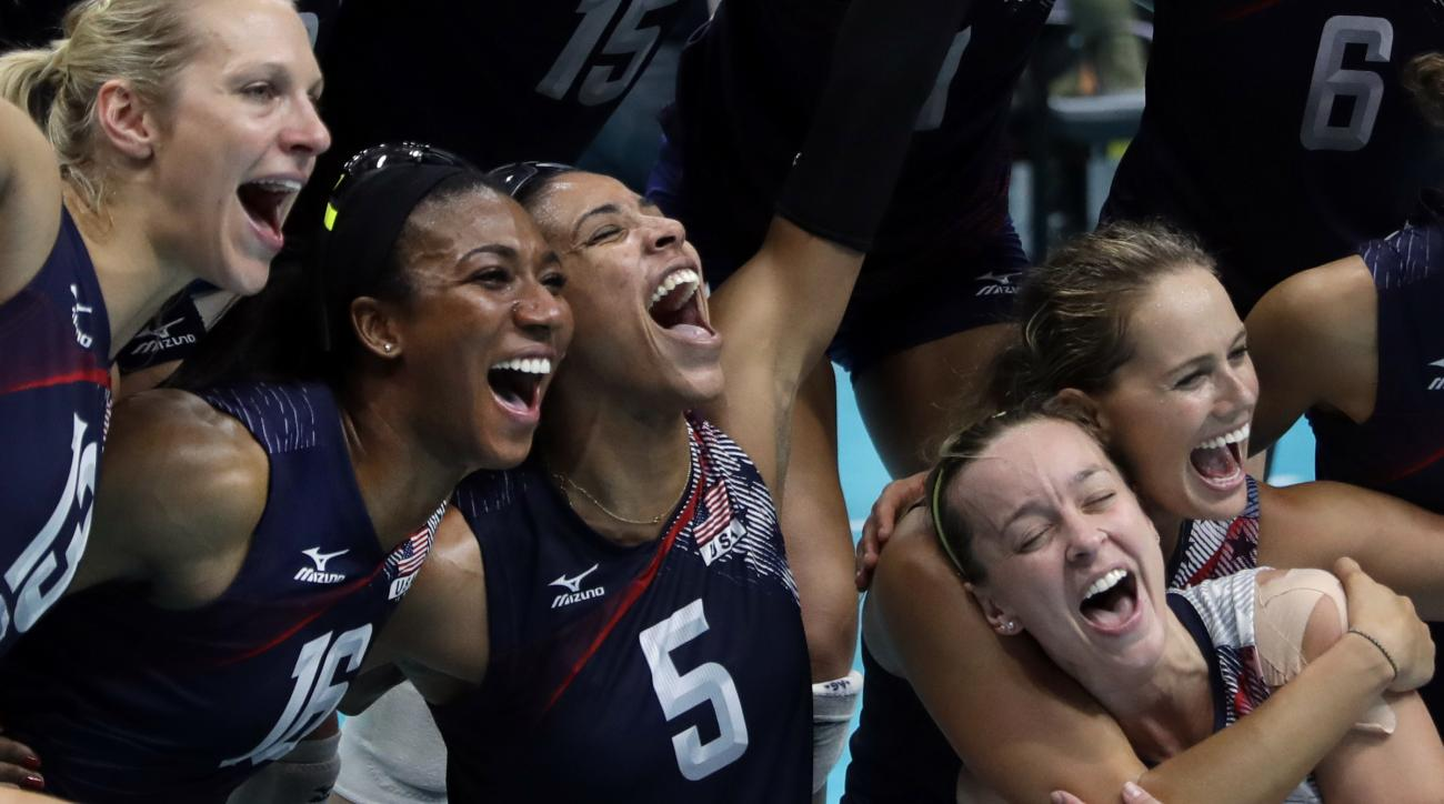 Members of the the United States team celebrate after defeating the Netherlands during a women's bronze medal volleyball match at the 2016 Summer Olympics in Rio de Janeiro, Brazil, Saturday, Aug. 20, 2016. The United States won 3-1. (AP Photo/Jeff Robers