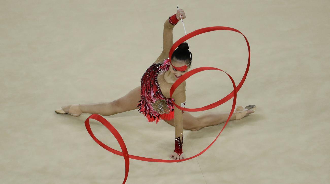 South Korea's Son Yeon-jae performs during the rhythmic gymnastics individual all-around final at the 2016 Summer Olympics in Rio de Janeiro, Brazil, Saturday, Aug. 20, 2016. (AP Photo/Dmitri Lovetsky)