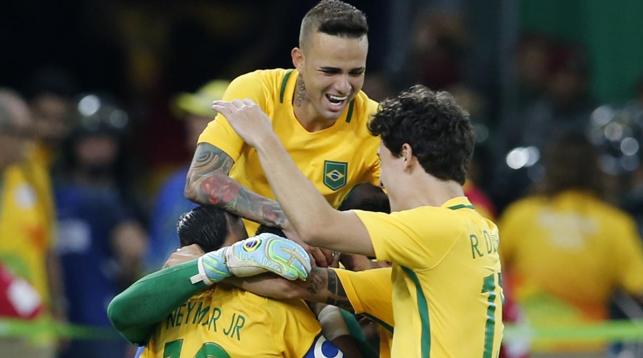 Brazil's Neymar, left, celebrates with his teammates their victory over Germany during the final of the men's Olympic football tournament at Maracana stadium in Rio de Janeiro, Brazil, Saturday, Aug. 20, 2016. Brazil won the match and the gold medal in a