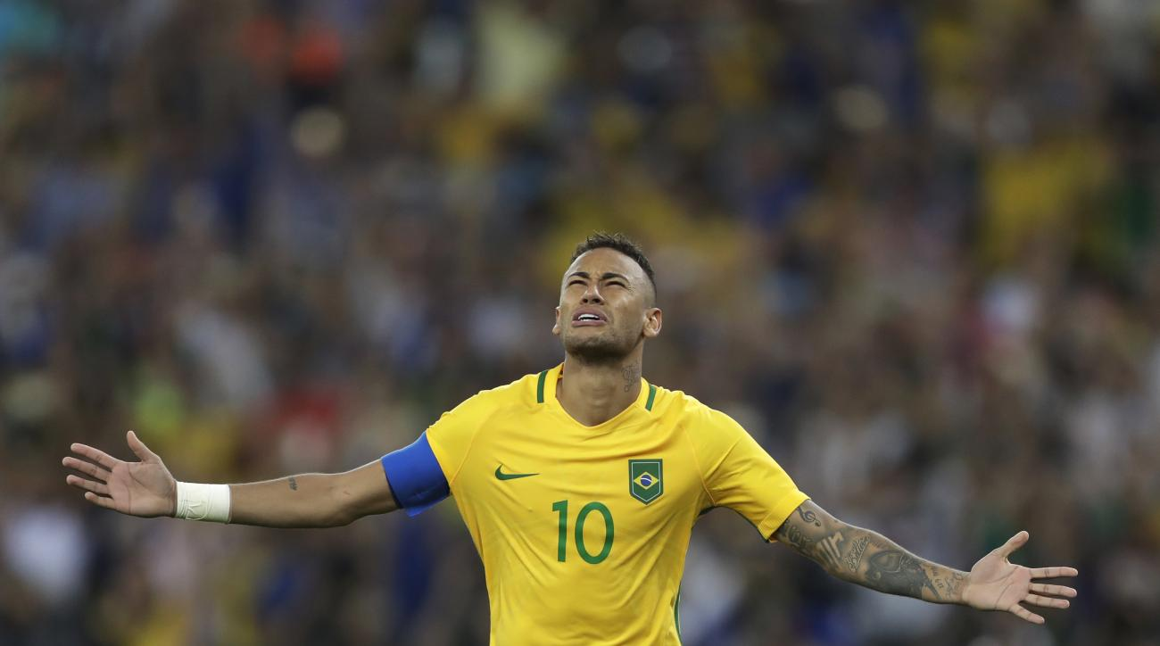 Brazil's Neymar celebrates after scoring the decisive penalty kick during the final match of the men's Olympic football tournament between Brazil and Germany at the Maracana stadium in Rio de Janeiro, Brazil, Saturday Aug. 20, 2016. Brazil won the gold me