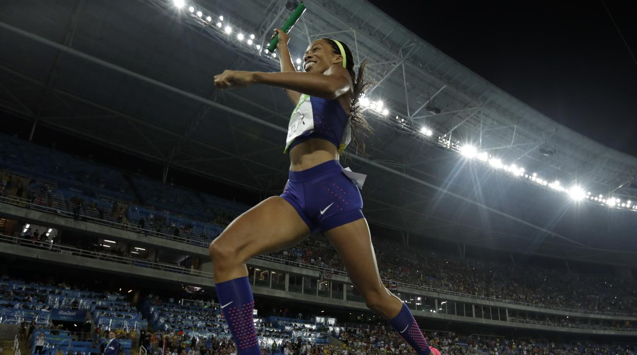 United States' Allyson Felix crosses the line to win gold in the women's 4x400-meter final during the athletics competitions of the 2016 Summer Olympics at the Olympic stadium in Rio de Janeiro, Brazil, Saturday, Aug. 20, 2016. (AP Photo/Matt Slocum)
