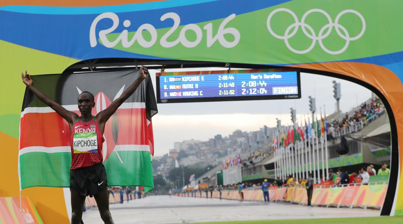 Kenya's Eliud Kipchoge celebrates after winning the men's marathon at the 2016 Summer Olympics in Rio de Janeiro, Brazil, Sunday, Aug. 21, 2016. (AP Photo/Petr David Josek)
