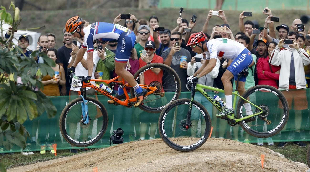 Peter Sagan of Slovakia, left, and Marco Aurelio Fontana of Italy compete in the men's cross-country cycling mountain bike race at the 2016 Summer Olympics in Rio de Janeiro, Brazil, Saturday, Aug. 20, 2016. (AP Photo/Patrick Semansky)