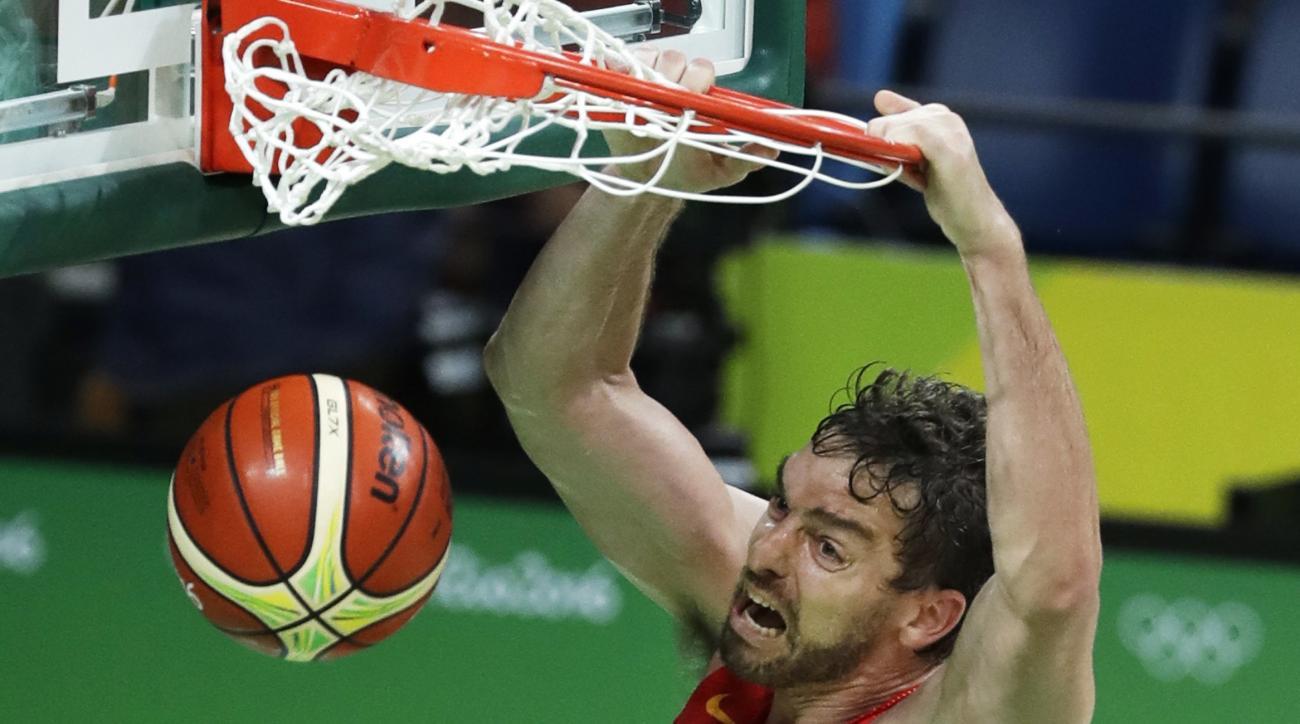 Spain's Pau Gasol (4) dunks the ball over Australia's Matthew Dellavedova during the bronze medal basketball game at the 2016 Summer Olympics in Rio de Janeiro, Brazil, Sunday, Aug. 21, 2016. (AP Photo/Charlie Neibergall)