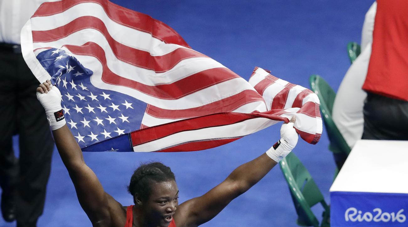 United States' Claressa Maria Shields celebrates after winning her gold medal for the women's middleweight 75-kg boxing at the 2016 Summer Olympics in Rio de Janeiro, Brazil, Sunday, Aug. 21, 2016. (AP Photo/Kirsty Wigglesworth)