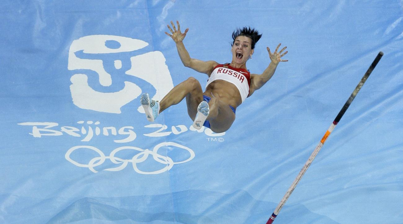 FILE - In this Aug. 18, 2008 file photo Russia's Yelena Isinbayeva breaks the world record as she wins gold in the women's pole vault final during the athletics competitions in the National Stadium at the Beijing 2008 Olympics in Beijing. While Russia wou
