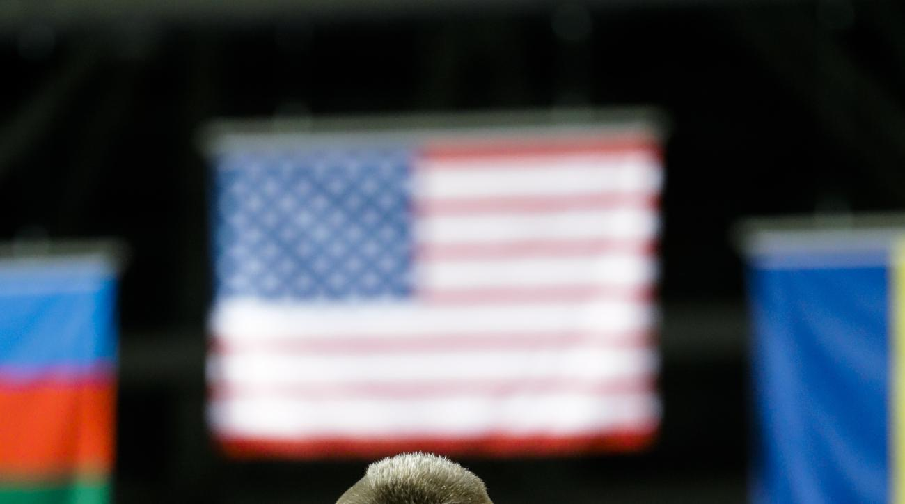 Gold medalist United States' Kyle Frederick Snyder listen to the United Staes' national anthem during the winners ceremony of the men's 97-kg freestyle wrestling competition at the 2016 Summer Olympics in Rio de Janeiro, Brazil, Sunday, Aug. 21, 2016. (AP