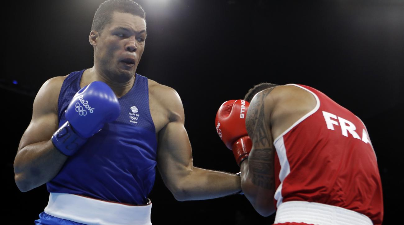 Britain's Joe Joyce, left, fights France's Tony Victor James Yoka during a men's super heavyweight over 91-kg final boxing match at the 2016 Summer Olympics in Rio de Janeiro, Brazil, Sunday, Aug. 21, 2016. (AP Photo/Frank Franklin II)