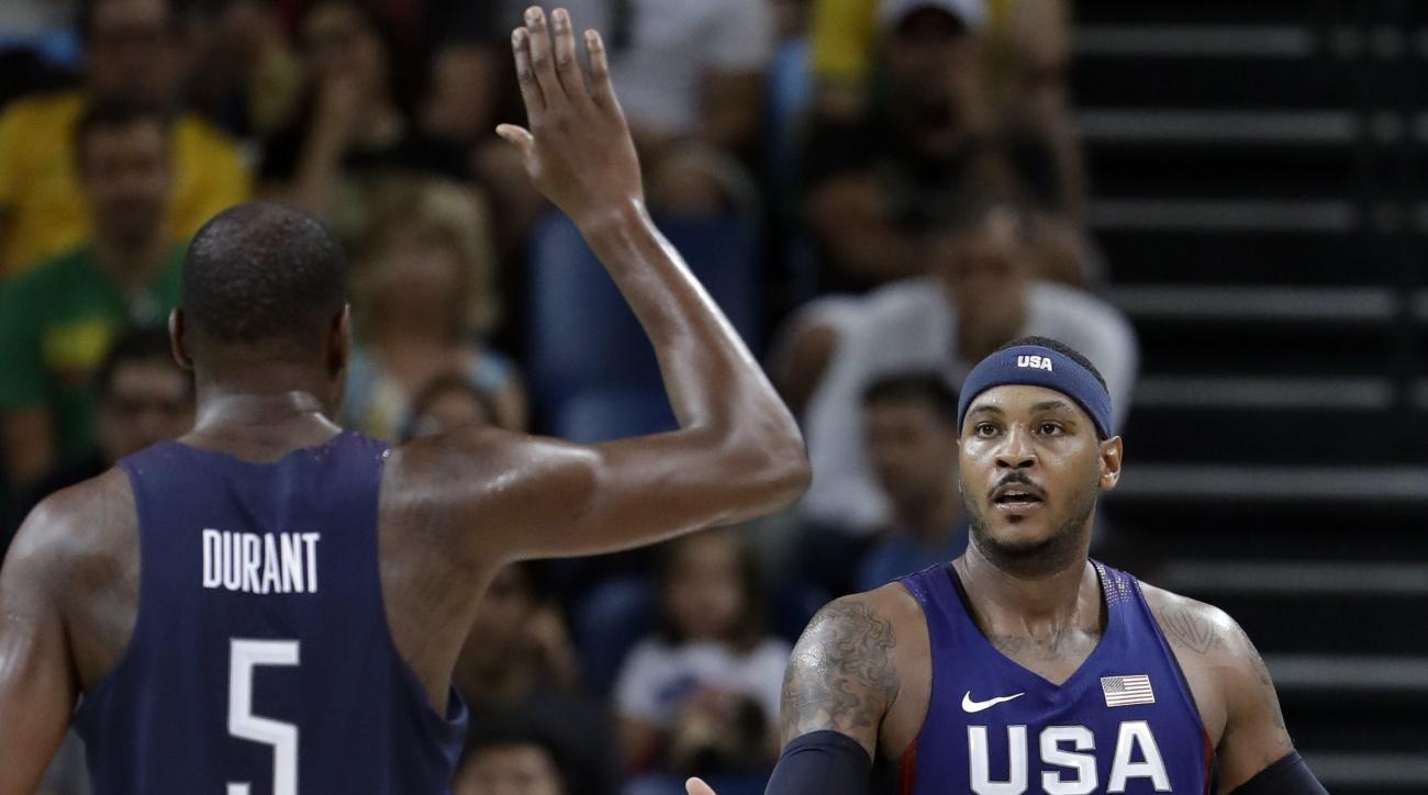 United States' Carmelo Anthony (15) celebrates with teammate Kevin Durant (5) during a men's semifinal round basketball game against Spain at the 2016 Summer Olympics in Rio de Janeiro, Brazil, Friday, Aug. 19, 2016. (AP Photo/Eric Gay)