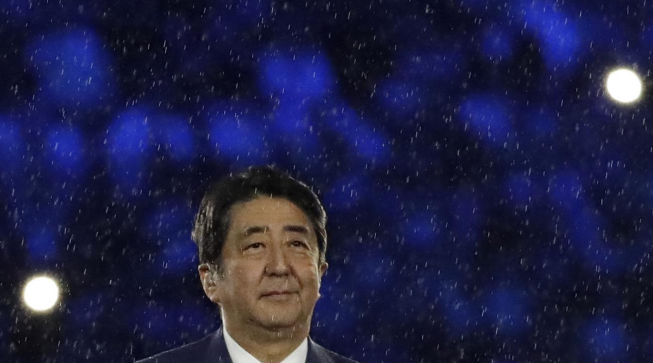 Japan's Prime Minister Shinzo Abe appears during the closing ceremony in the Maracana stadium at the 2016 Summer Olympics in Rio de Janeiro, Brazil, Sunday, Aug. 21, 2016. (AP Photo/Matt Dunham)