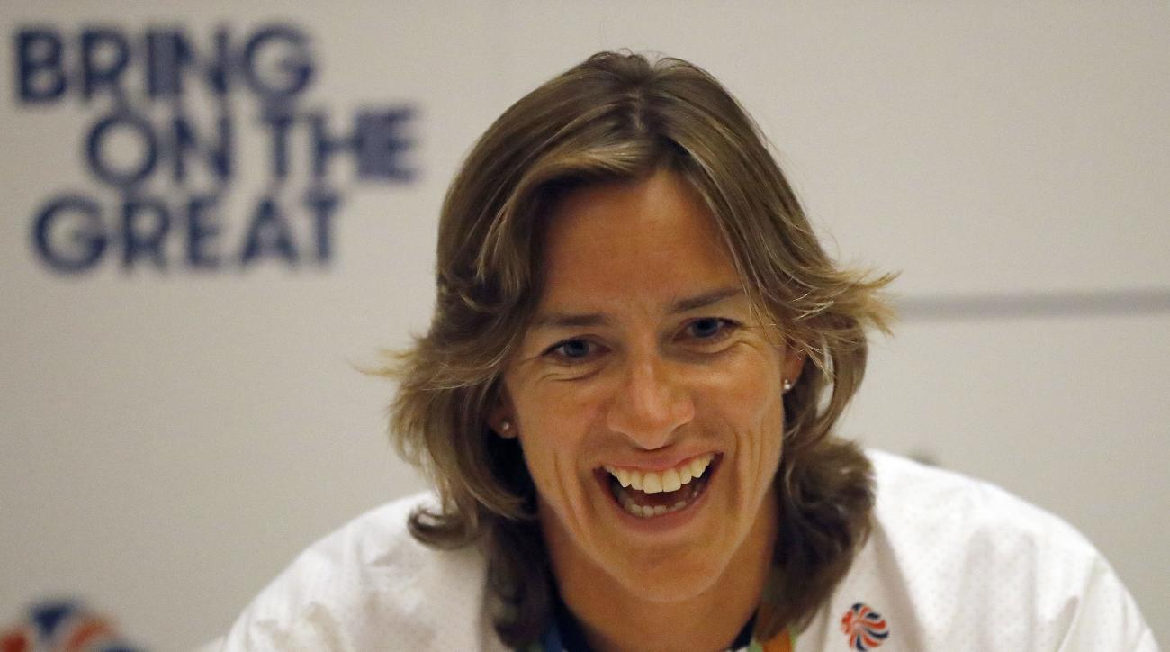 British rower Katherine Grainger laughs, during a press conference after the Team Great Britain's return from the Rio De Janeiro Olympics, at Heathrow airport in London, Tuesday, Aug. 23, 2016. (AP Photo/Frank Augstein)
