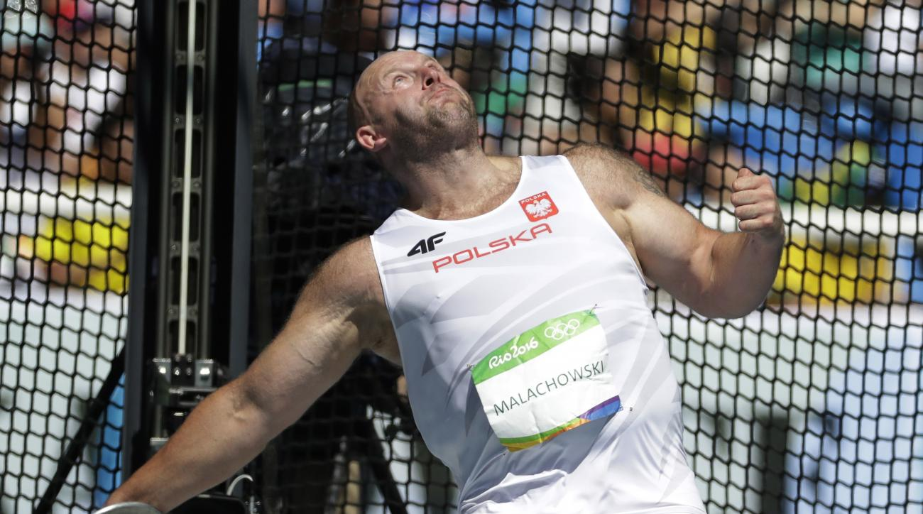 Poland's Piotr Malachowski makes an attempt in the men's discus throw final during the athletics competitions of the 2016 Summer Olympics at the Olympic stadium in Rio de Janeiro, Brazil, Saturday, Aug. 13, 2016. (AP Photo/Matt Dunham)