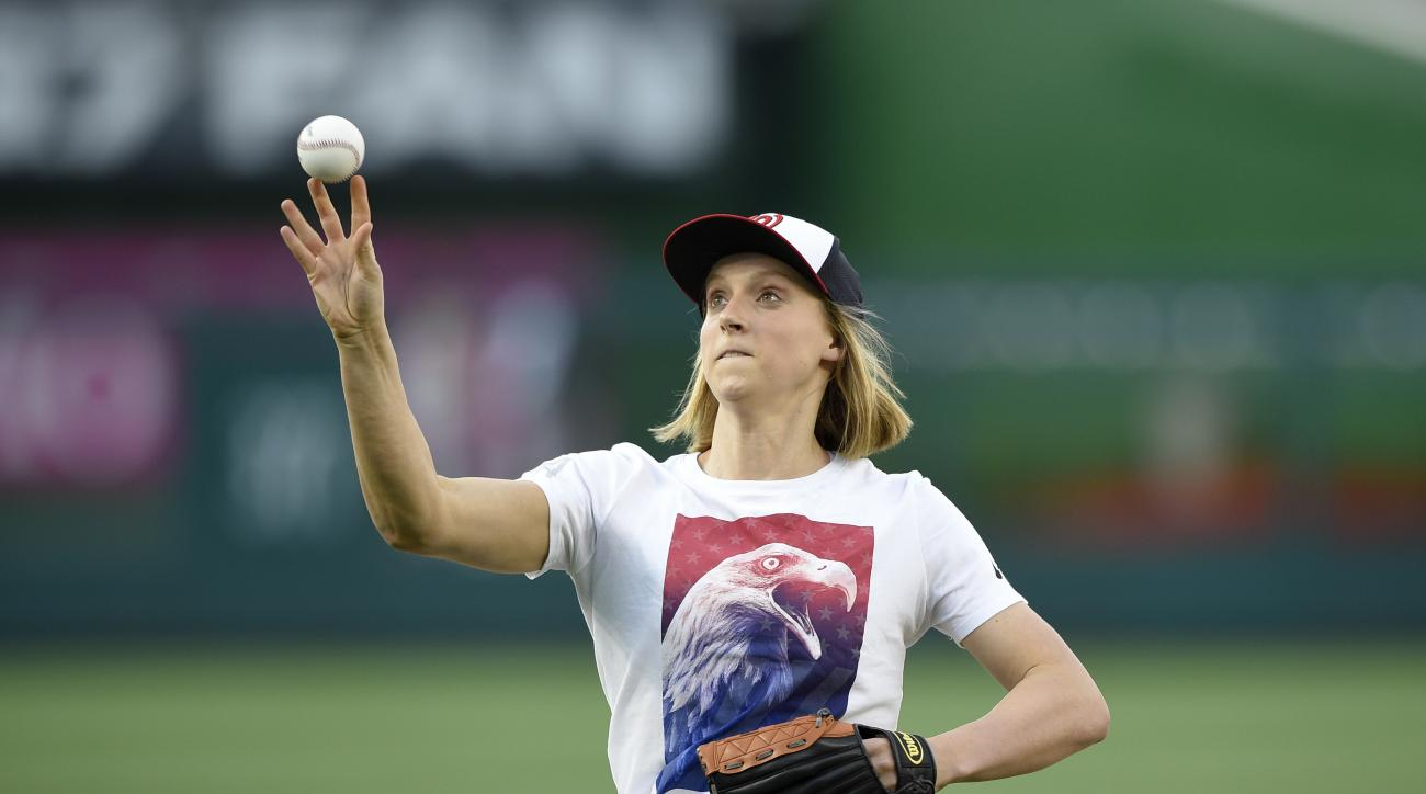 FILE - In this Aug. 24, 2016, file photo, Olympic gold medal swimmer Katie Ledecky throws out the ceremonial first pitch before a baseball game between the Baltimore Orioles and the Washington Nationals in Washington. Ledecky is enjoying quite a victory t