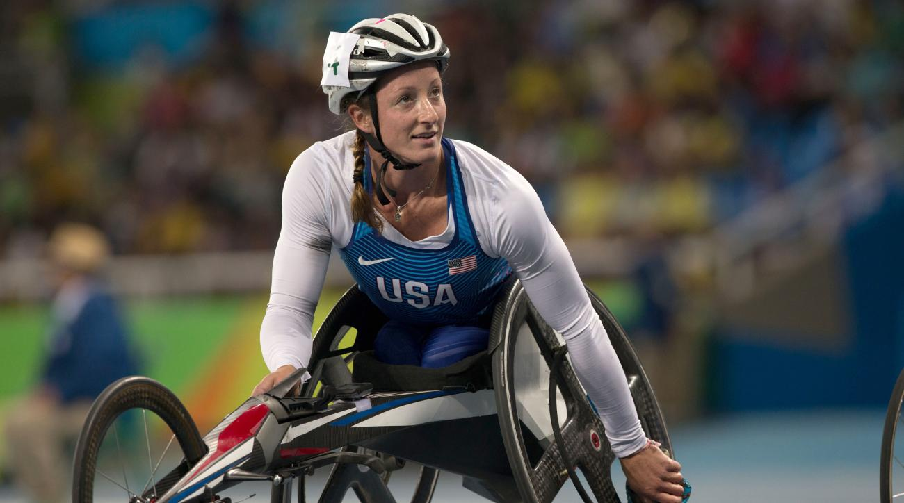 United States' Tatyana McFadden slows to a roll after competing in the first heat of the women's 100-meter T54 athletics event of the Paralympic games in Rio de Janeiro, Brazil, Thursday, Sept. 8, 2016. (AP Photo/Mauro Pimentel)