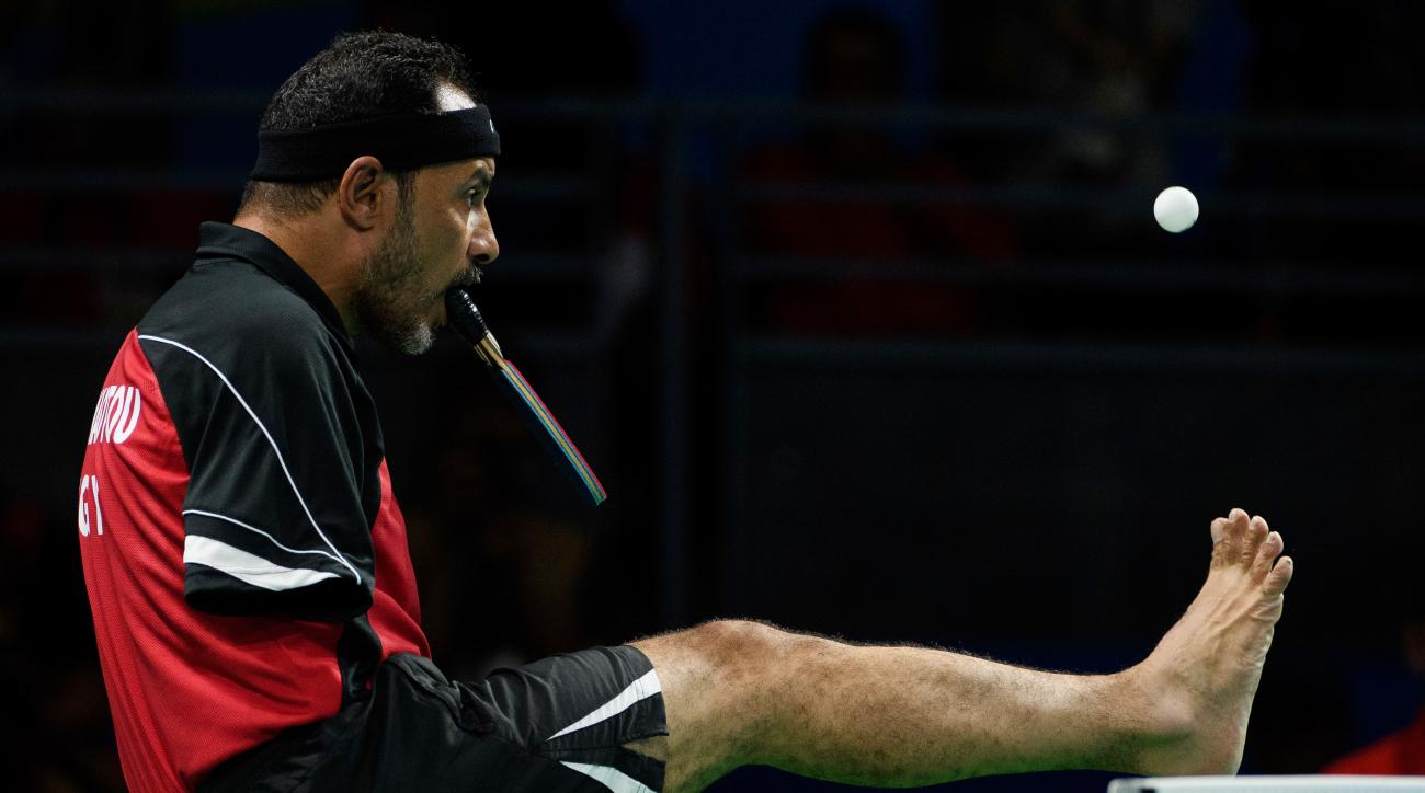 In this photo released by the IOC, Egypt's Ibrahim Hamadtou plays Germany's Thoma Rau in a men's table tennis event during the Paralympic Games in Rio de Janeiro, Brazil, Friday, Sept. 9, 2016. (Thomas Lovelock/OIS,IOC via AP)