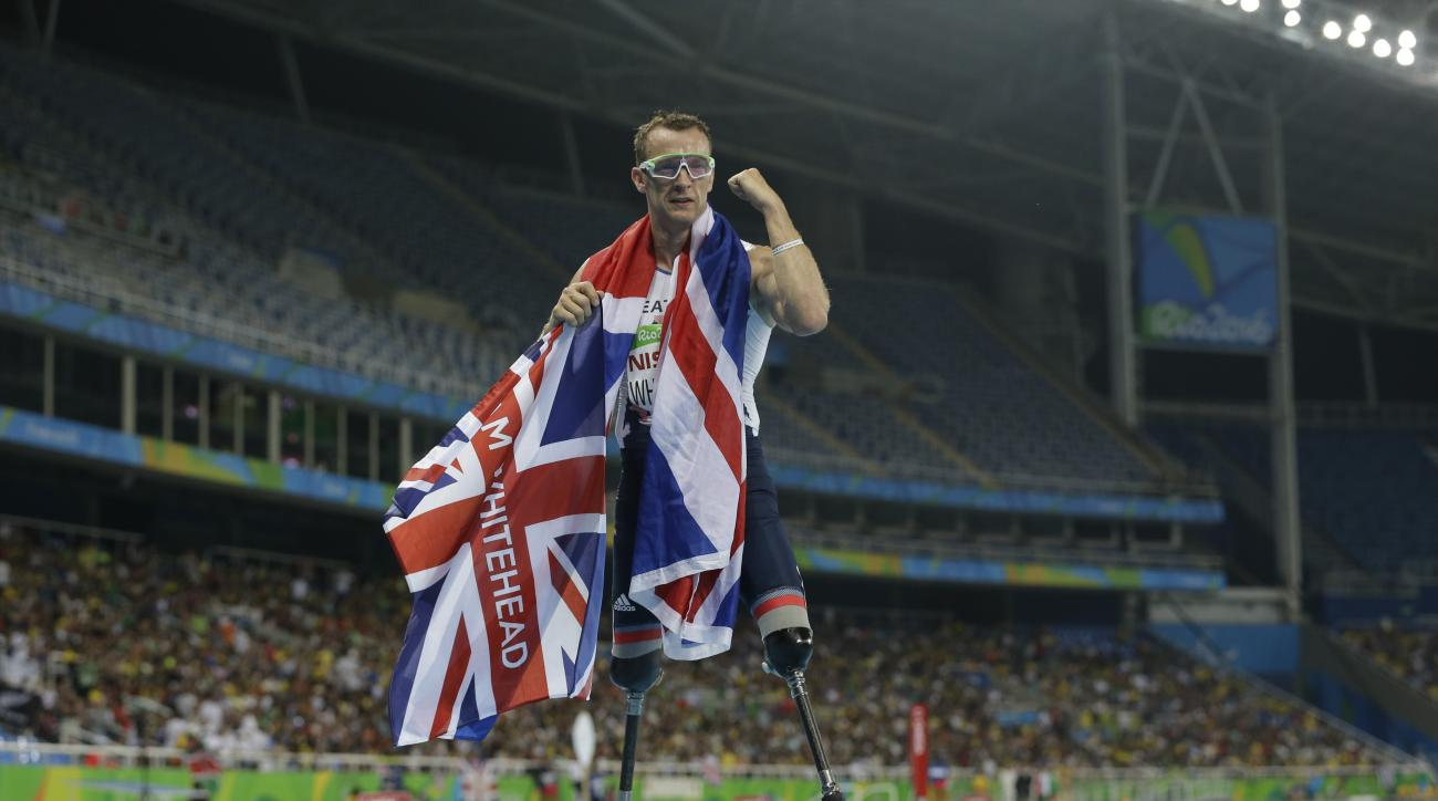 Britain's Richard Whitehead celebrates winning the gold medal in the men's 200-meter - T42 final event of the Paralympic Games in Rio de Janeiro, Brazil, Sunday, Sept. 11, 2016. (AP Photo/Leo Correa)